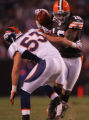 (CS1096)Joshua Cribbs shakes a tackle by Niko Koutouvides in the third quarter of the Denver...