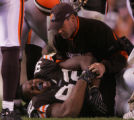 (CS1191) Cleveland trainers attend to lineman Shaun Rogers in the third quarter of the Denver...