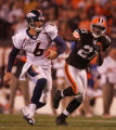 (CS1362) Jay Cutler scrambles for yards past Brodney Pool in the fourth quarter of the Denver...