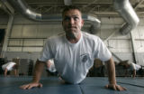 Recruit officer Jeremy Cain (cq), 26, of Denver, does 50 push-ups during training at the Denver...