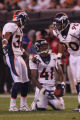 (CS1706) Karl Paymah  is congratulated by Dre Bly and Kenny peterson after recovering a fumble in...