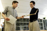 CU physicist and professor Carl Wieman (cq), left,  sees his colleague Eric Cornell's (cq)...