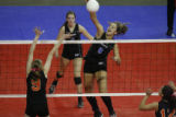 DM9064  Grandview's Erica Denney spikes the ball past Lakewood's Shayne Brown during the CHSAA...
