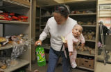 Glenis Santos (cq) and her 6 month old daughter, Kristal Padilla, get some food, Friday morning,...