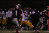 #1 Billy Holifield (cq) of Heritage runs towards #2 Erik Fielder (cq) of Sierra during the first...