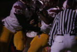 #47 Dontre Walker (cq) of Sierra is pushed in to the endzone by his teammate #56 Terence Thomas...