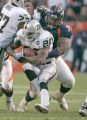 0844 Oakland Raiders running back Darren McFadden #20 is tackled by Denver Broncos defensive...