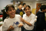 Berenice Carrillo, 10, (cq) laughs with Julie Rimbert, 10, (cq) during an exercise in math class...