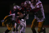 #13 Mitch Griebel (cq) of Heritage stiff arms #51 James Hairston-Abbott (cq) of Sierra during the...