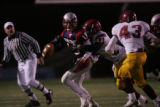#13 Mitch Griebel (cq) of Heritage is tackled by #31 Clarence Bumpas (cq) of Sierra during the...