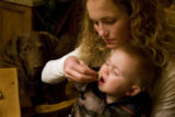 3-time Olympian Sarah Schleper feeds her son, Lasse Gaxiola, during an early Christmas dinner at...