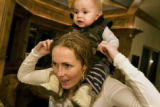 3-time Olympic ski racer Sarah Schleper with her 10-month-old son Lasse Gaxiola, in her father,...