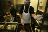 Agustin Garcia (cq) fries a turkey at Bayou Bob's, 1635 Glenarm Place in Denver on Monday,...