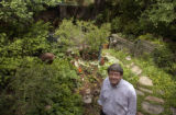 Steve Kiely stands in his backyard Denver garden.  Steve Kiely and Mike Gonser have put 23 years...