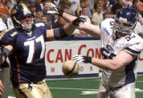 Colorado Crush lineman, Donny Klein (left #77) and Chicago Rush defensive lineman, Scott Popisil...