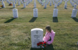 (025) Leila Holland (cq), 4, of Colorado Springs, stands next to the gravestone of her great-uncle...
