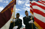 (299) Members of the Honor Guard John Vaglienti, left, and Vince Neuroth, right, prepare the flags...