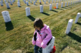(662) Leila Holland (cq), 4, of Colorado Springs, stands next to the gravestone of her great-uncle...