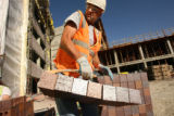 MJM927  Charles Cruz (cq) of Glover Masonry works on the Auraria Science Building Addition and...