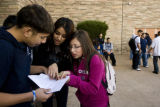 Luis Aguilar, 15, (cq) Ilse Chip, 15, (cq) and Yudi Romo, 15, (cq)  work a math problem outside of...