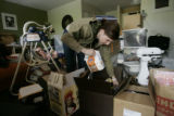 HGTV DREAM HOUSE.  MAY 26, 2005.   Tina Galgon-Herr repacks a box of food from the kitchen after a...