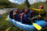 Billy Mattison (cq), right, talks to a group of tourists about rafting Tuesday morning June 1,...