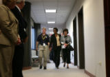 (PG16511) Rhonda Marshall-Fields (center) and Christine Wolfe leave the courtroom after the...