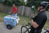 DM0142  Denver Police officer Les Tucker stops to talk to an ice cream vendor to remind him that...