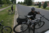 DM0187  Denver Police officer Les Tucker loads his bicycle back onto his patrol vehicle after...