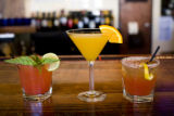 Three tasty kinds of adult beverages, from left to right, Watermelon-basil Mojito, Manderin Silk...
