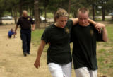 Golden, Colo., photo taken May 27, 2004-Eric Wilson (right) helps friend and fellow cadet Sara...