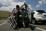 Ken Hougland (cq) talks with his grandson Evan McCune, 10 (cq) while he loads their car with his...