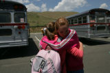 Megan Woody, 12, (cq) of Denver, says goodbye to her friend Rhianna Williams, 12, (cq) of...