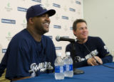 WIMG105 - Milwaukee Brewers new pitcher C.C. Sabathia, left, smiles with manager Ned Yost as he...