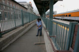 Tony Abeyta (cq), sweeps at Union Station Monday afternoon, Ski Train to the right, June 23, 2008,...