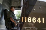 (003)  UPS driver Tim Hernandez makes his delivery stop on his regular route around Broomfield,...