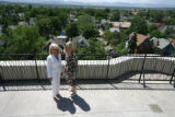 Realtor Diane Huttner takes Debi Tepper on a tour of the rooftop with a mountain view at the...
