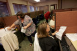 Administrative assistant Sue Chavez (cq) helps workers input voter registration data at the new...