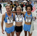 Women's Team USA, Colleen De Reuck, Jen Rhines, and Elva Dryer, pose for a photograph after...