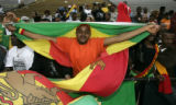 Ethiopia fan, Seife Tesfemariam, 26, of Denver, holds up a Ethiopian flag as he and others...