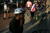 Calvin Gipson (cq) tries on his new bike helmet outside a breakfast station at REI. Craig's...