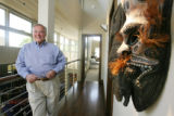 Homeowner Donald Yale, stands by his collection of masks in his home in Denver on June 10, 2008. ...
