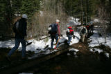 Volunteers for Outdoor Colorado hike with gear to repair Tanglewood trail on Mt. Evans.   May 17,...