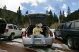 Gary Ambrose, (cq) of Denver drinks a jug of water from the trunk of his car after he and other...