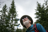 Dave Damouth, (cq) of Golden listens to safety instructions before he and other volunteers begin...