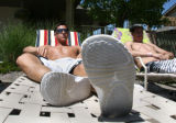 Brian Aragon (cq) hangs with friends at the pool at Lambertson Farms Apartmentrs, Tuesday...