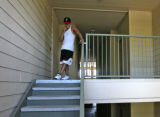Brian Aragon (cq) leaves his apartment, heading to the pool, at Lambertson Farms Apartmentrs,...