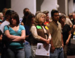 PHOTO BY GRETEL DAUGHERTY Folks wait for their turn at the microphone Tuesday at a public forum...