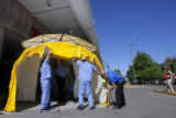 DM0013  A decontamination tent is quickly set up outside Presbyterian St. Luke's Hospital during a...