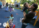 DM0504  Amber Shearer, 24, picks up her two-year-old twins Atticus, in her arms, and Damia Tyler,...